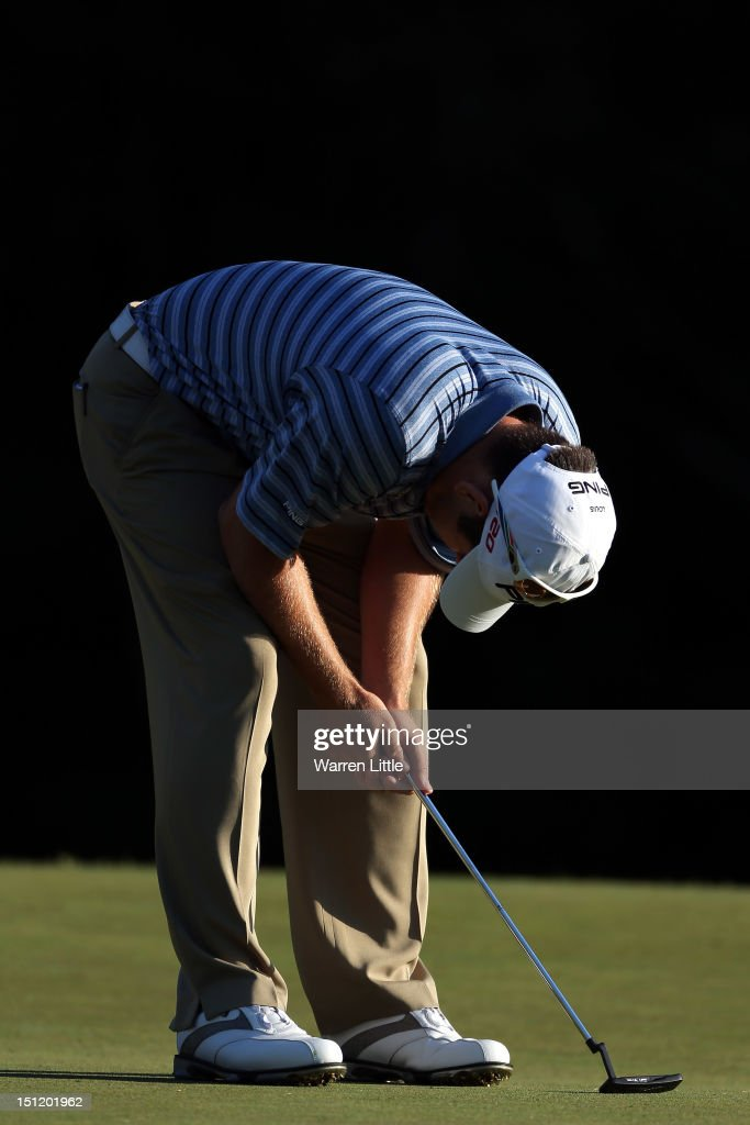 Louis Oosthuizen of South Africa reacts after missing a putt on the 18th green to force a playoff with Rory McIlroy of Northern Ireland during the final round of the Deutsche Bank Championship at TPC Boston on September 3, 2012 in Norton, Massachusetts.