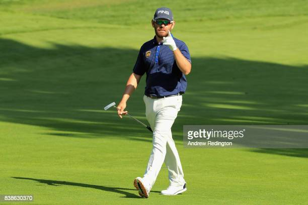 Louis Oosthuizen of South Africa reacts after playing a shot on the fourth hole during round one of The Northern Trust at Glen Oaks Club on August 24...