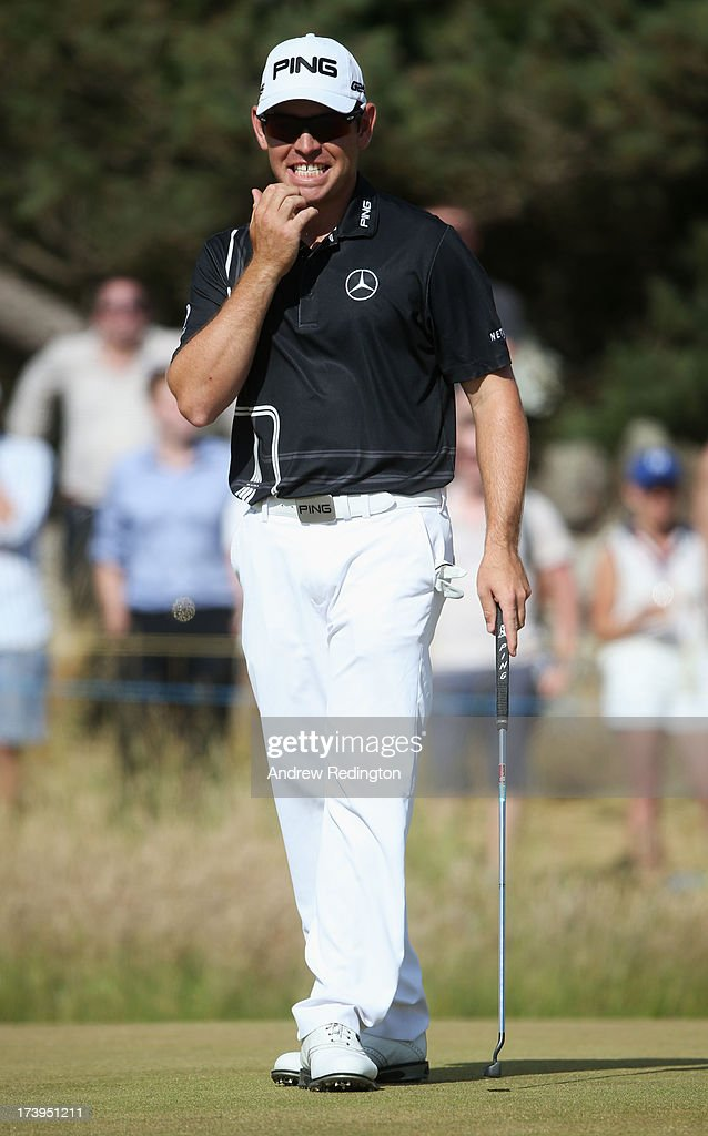 Louis Oosthuizen of South Africa reacts during the first round of the 142nd Open Championship at Muirfield on July 18, 2013 in Gullane, Scotland.