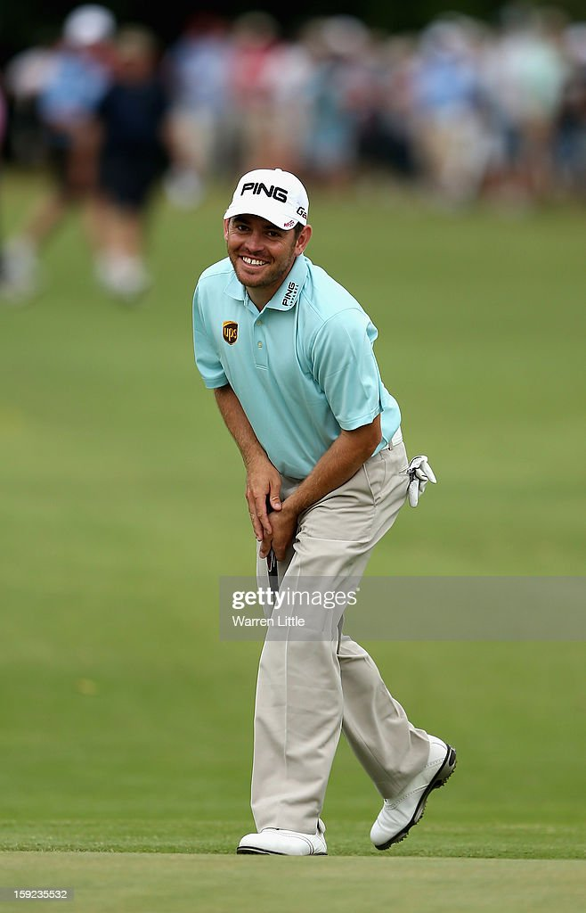 <a gi-track='captionPersonalityLinkClicked' href=/galleries/search?phrase=Louis+Oosthuizen&family=editorial&specificpeople=241573 ng-click='$event.stopPropagation()'>Louis Oosthuizen</a> of South Africa reacts to a missed putt during the first round of the Volvo Golf Champions at Durban Country Club on January 10, 2013 in Durban, South Africa.