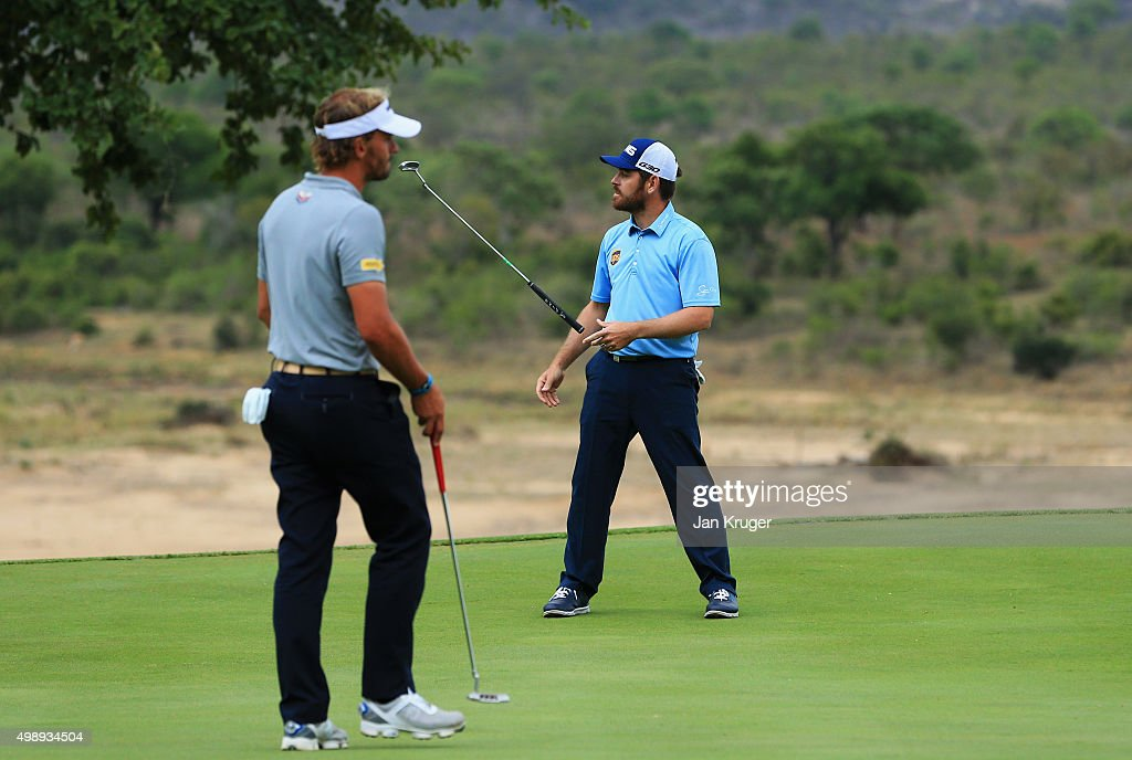 Louis Oosthuizen of South Africa (R) reacts to a missed putt on the 13th green as Joost Luiten of the Netherlands looks on during day two of the Alfred Dunhill Championship at Leopard Creek Country Golf Club on November 27, 2015 in Malelane, South Africa.