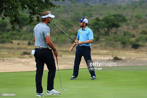 Louis Oosthuizen of South Africa reacts to a missed putt on the 13th green as Joost Luiten of the Netherlands looks on during day two of the Alfred...