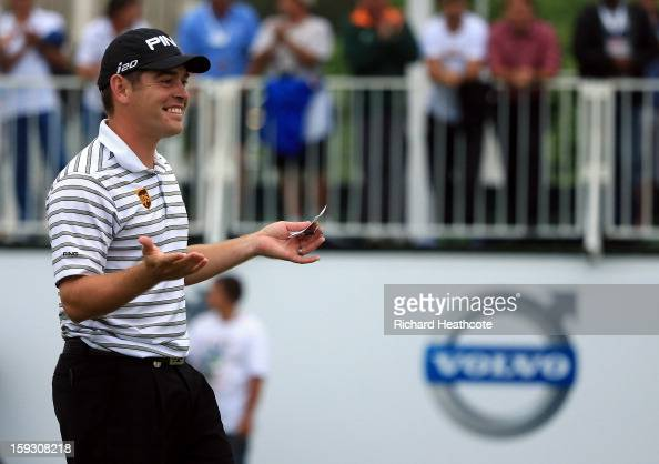 Louis Oosthuizen of South Africa reacts to amateur partner Colin Ledworth of England holing a birdie putt on the 18th green to help his team win the...