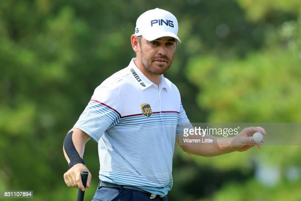 Louis Oosthuizen of South Africa reacts to his putt on the eighth green during the final round of the 2017 PGA Championship at Quail Hollow Club on...