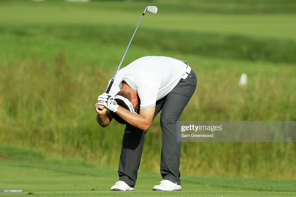 Louis Oosthuizen of South Africa reacts to his second hot on the ninth hole during the third round of the US Open at Oakmont Country Club on June 18...