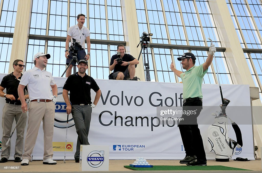 Louis Oosthuizen of South Africa reacts to his shot which hit the outside of the target watched by Padraig Harrington of Ireland and Branden Grace of South Africa during The Volvo Golf Champions Moses Mabhida Stadium Challenge as a preview for the 2014 Volvo Golf Champions tournament at Durban Country Club on January 7, 2014 in Durban, South Africa.