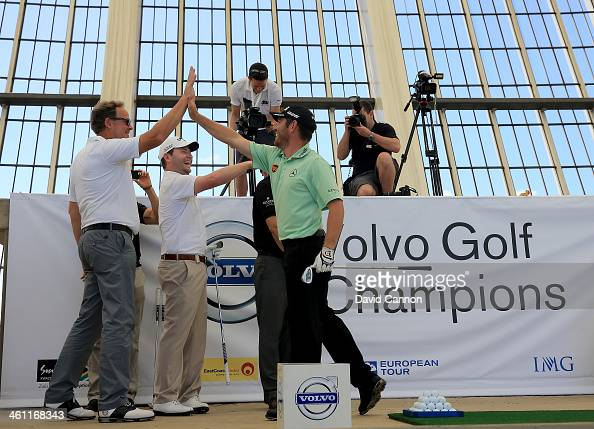Louis Oosthuizen of South Africa reacts to his shot which hit the outside of the target with Per Ericsson The President of Volvo Event Management...