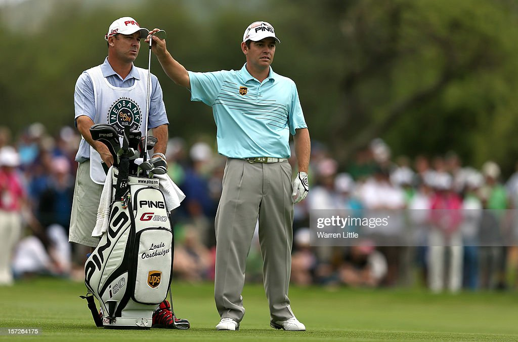 <a gi-track='captionPersonalityLinkClicked' href=/galleries/search?phrase=Louis+Oosthuizen&family=editorial&specificpeople=241573 ng-click='$event.stopPropagation()'>Louis Oosthuizen</a> of South Africa selects a club on the 18th hole during the third round of the Nedbank Golf Challenge at the Gary Player Country Club on December 1, 2012 in Sun City, South Africa.