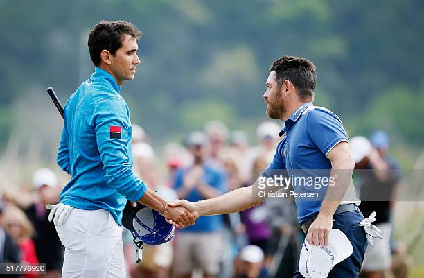 Louis Oosthuizen of South Africa shakes hands with Rafa CabreraBello of Spain after Oosthuizen won 43 on the 15th green during their semifinal match...