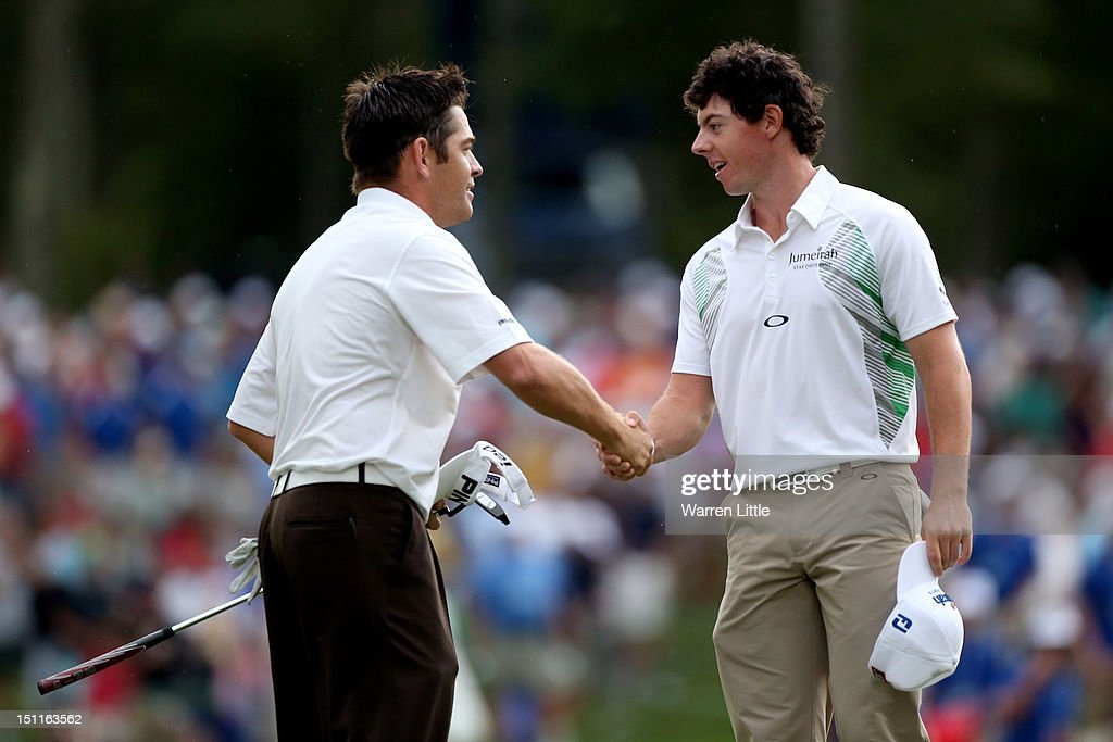 <a gi-track='captionPersonalityLinkClicked' href=/galleries/search?phrase=Louis+Oosthuizen&family=editorial&specificpeople=241573 ng-click='$event.stopPropagation()'>Louis Oosthuizen</a> of South Africa shakes hands with <a gi-track='captionPersonalityLinkClicked' href=/galleries/search?phrase=Rory+McIlroy&family=editorial&specificpeople=783109 ng-click='$event.stopPropagation()'>Rory McIlroy</a> of Northern Ireland after both players finish the third round of the Deutsche Bank Championship at TPC Boston on September 2, 2012 in Norton, Massachusetts.