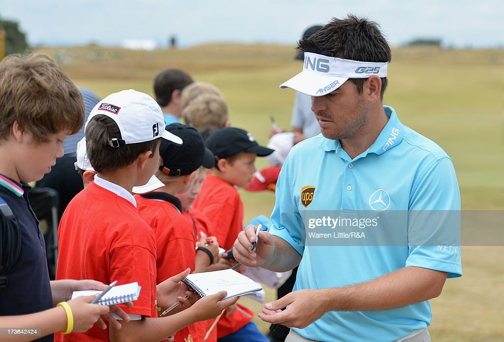 Louis Oosthuizen of South Africa signs autographs ahead of the 142nd Open Championship at Muirfield on July 16, 2013 in Gullane, Scotland.