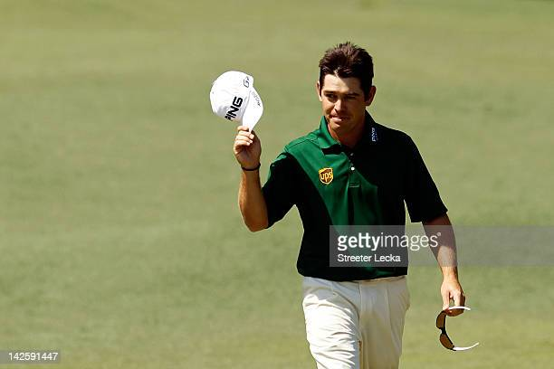 Louis Oosthuizen of South Africa smiles after making an albatross on the second hole during the final round of the 2012 Masters Tournament at Augusta...