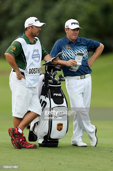 Louis Oosthuizen of South Africa stamds with his caddie Wynand Stander during the final round of the Volvo Golf Champions at Durban Country Club on...