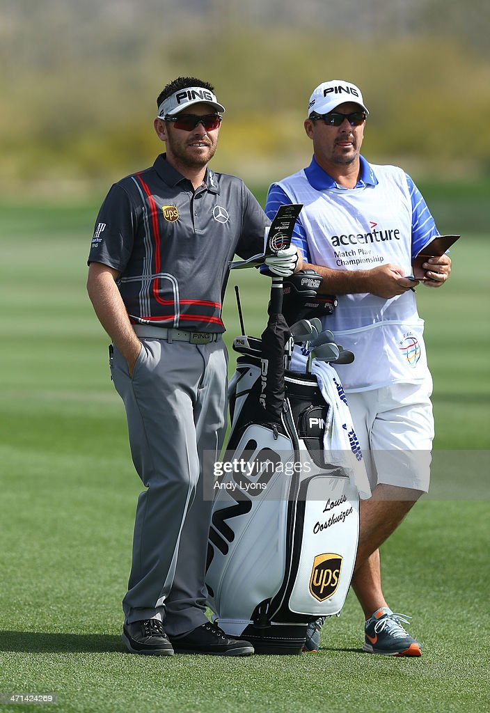 Louis Oosthuizen of South Africa stands with his caddie prior to playing a shot on the second hole during the third round of the World Golf Championships - Accenture Match Play Championship at The Golf Club at Dove Mountain on February 21, 2014 in Marana, Arizona.