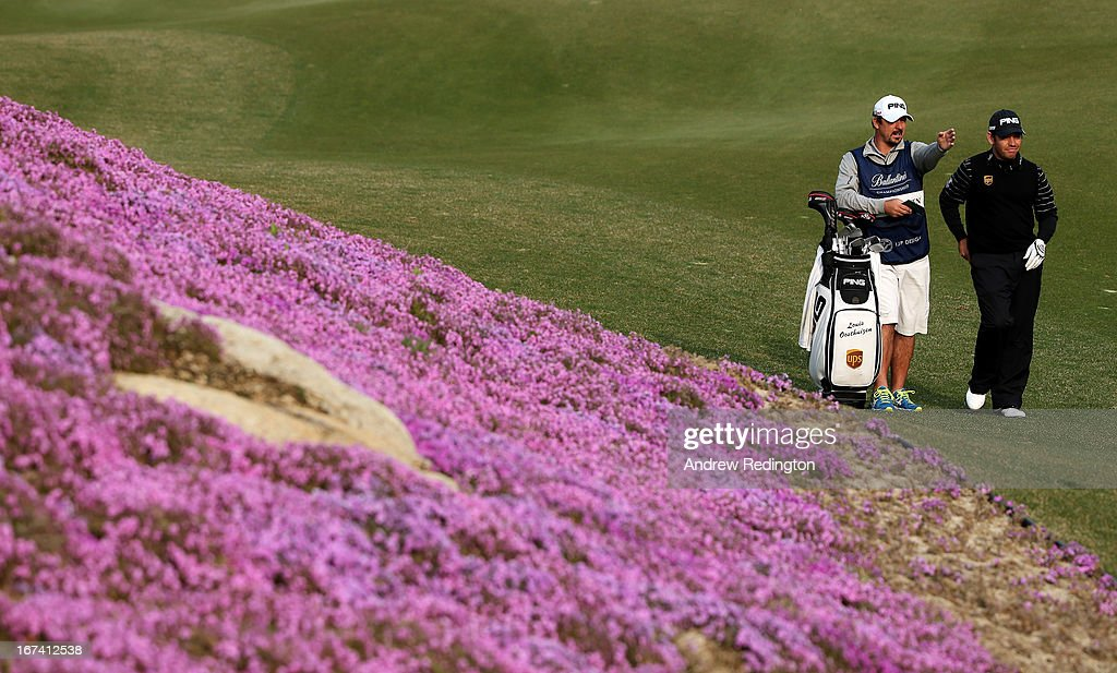 Louis Oosthuizen of South Africa stands with his caddie Wynand Stander on the tenth hole during the first round of the Ballantine's Championship at Blackstone Golf Club on April 25, 2013 in Icheon, South Korea.
