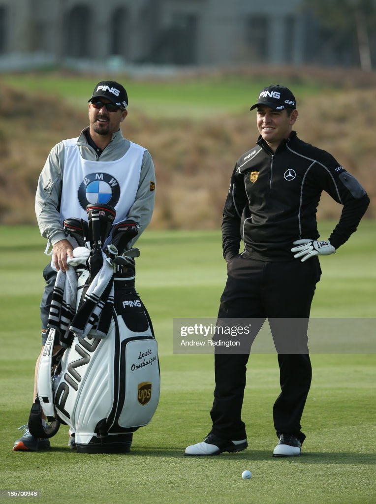 Louis Oosthuizen of South Africa stands with his caddie Wynand Stander during the first round of the BMW Masters at Lake Malaren Golf Club on October 24, 2013 in Shanghai, China.