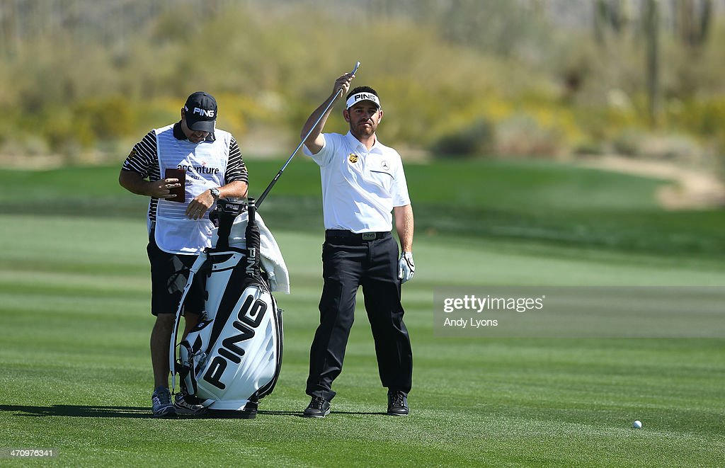 Louis Oosthuizen of South Africa takes a club out of his bag prior to a shot on the second hole during the second round of the World Golf Championships - Accenture Match Play Championship at The Golf Club at Dove Mountain on February 20, 2014 in Marana, Arizona.