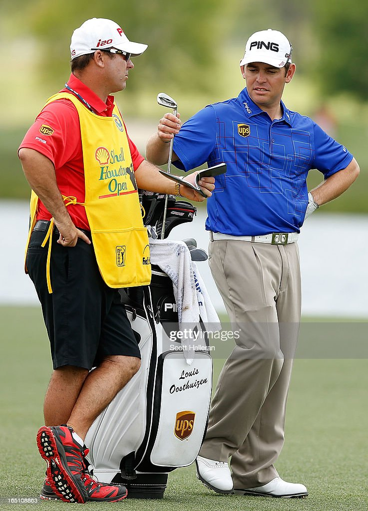 Louis Oosthuizen of South Africa talks with his caddie Wynand Stander on the 18th hole during the third round of the Shell Houston Open at the Redstone Golf Club on March 30, 2013 in Humble, Texas.