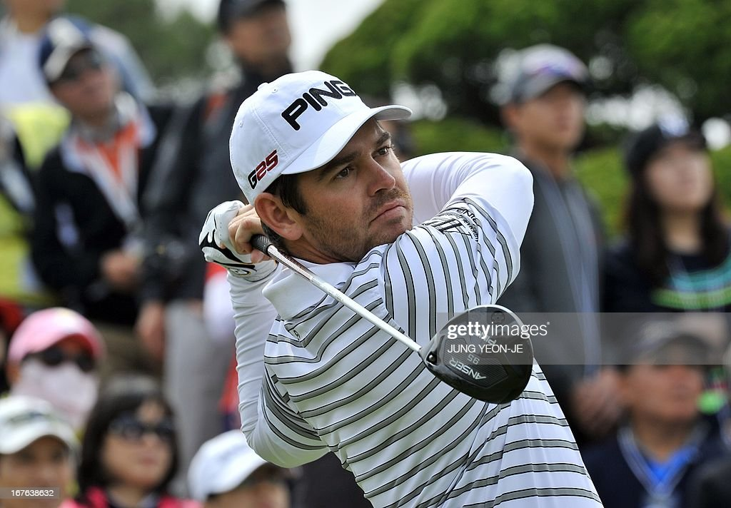 Louis Oosthuizen of South Africa tees off at the 1st hole during the third round of the Ballantine's Championship at Blackstone Golf Club in Icheon, 70 kms southeast of Seoul, on April 27, 2013.
