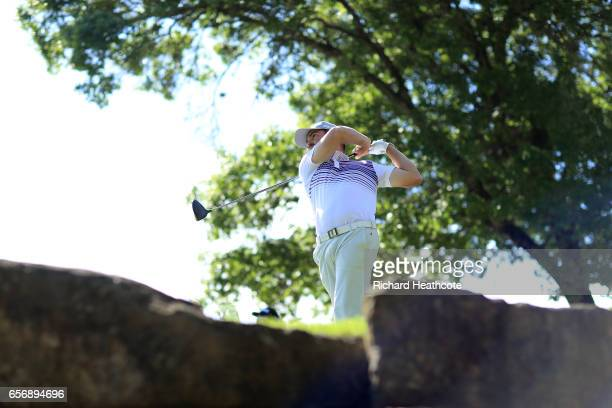 Louis Oosthuizen of South Africa tees off on the 5th hole of his match during round two of the World Golf ChampionshipsDell Technologies Match Play...