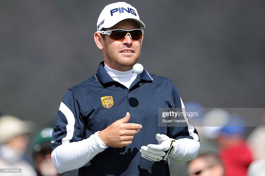 Louis Oosthuizen of South Africa tosses a ball in the air as he looks on from the third hole tee box during the first round of the World Golf Championships - Accenture Match Play at the Golf Club at Dove Mountain on February 21, 2013 in Marana, Arizona. Round one play was suspended on February 20 due to inclimate weather and is scheduled to be continued today.