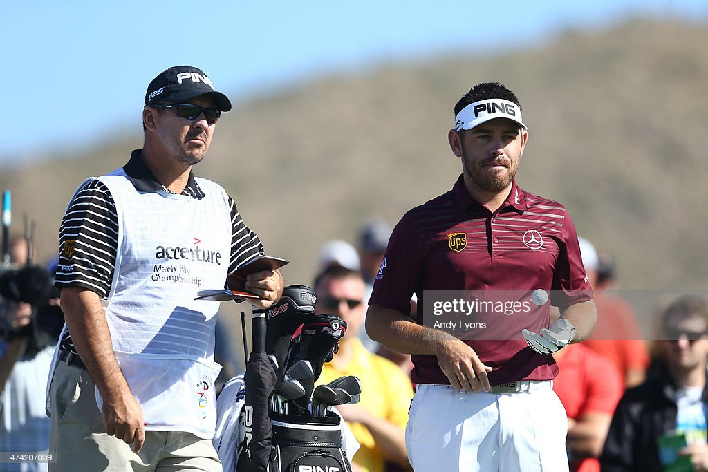 Louis Oosthuizen of South Africa tosses the ball in his hand before his tee shot on the third hole during the quarterfinal of the World Golf Championships - Accenture Match Play Championship at The Golf Club at Dove Mountain on February 22, 2014 in Marana, Arizona.