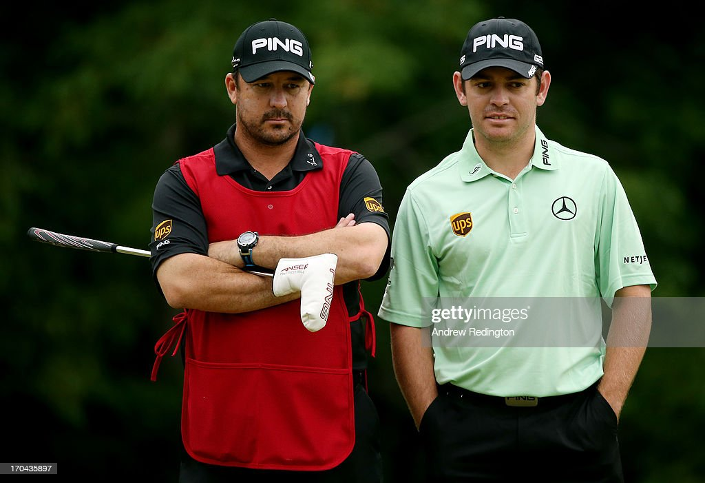 Louis Oosthuizen of South Africa waits alongside his caddie Wynand Stander on the 12th hole during Round One of the 113th U.S. Open at Merion Golf Club on June 13, 2013 in Ardmore, Pennsylvania.