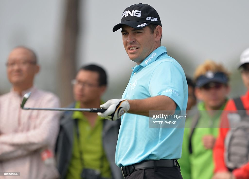 Louis Oosthuizen of South Africa waits to tee off at the 2nd tee during the first round of the BMW Shanghai Masters golf tournament at the Lake Malaren Golf Club in Shanghai on October 24, 2013. AFP PHOTO/Peter PARKS