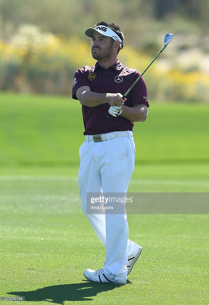 Louis Oosthuizen of South Africa watches his second shot on the fourth hole during the quarterfinal of the World Golf Championships - Accenture Match Play Championship at The Golf Club at Dove Mountain on February 22, 2014 in Marana, Arizona.