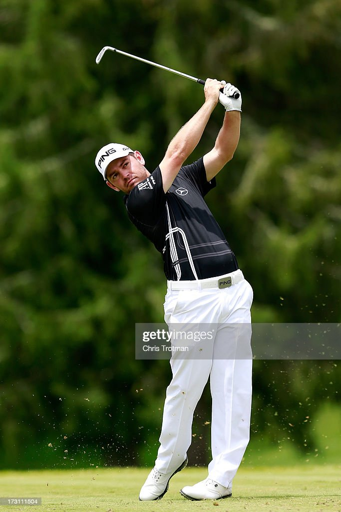 Louis Oosthuizen of South Africa watches his tee shot on the third hole during the final round of the Greenbrier Classic at the Old White TPC on July 7, 2013 in White Sulphur Springs, West Virginia.