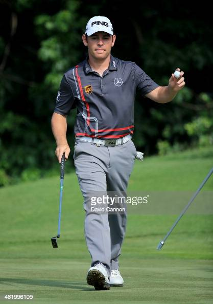 Louis Oosthuizen of South Africa waves to the crowd on the 17th green after making a tapin birdie during the final round of the 2014 Volvo Golf...
