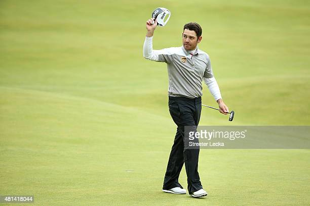 Louis Oosthuizen of South Africa waves to the crowd on the 18th green during the final round of the 144th Open Championship at The Old Course on July...