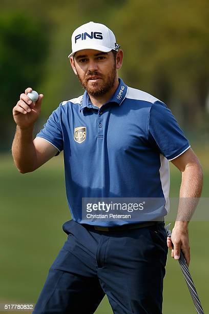 Louis Oosthuizen of South Africa waves to the gallery on the sixth green during his semifinal match with Rafa CabreraBello at the World Golf...