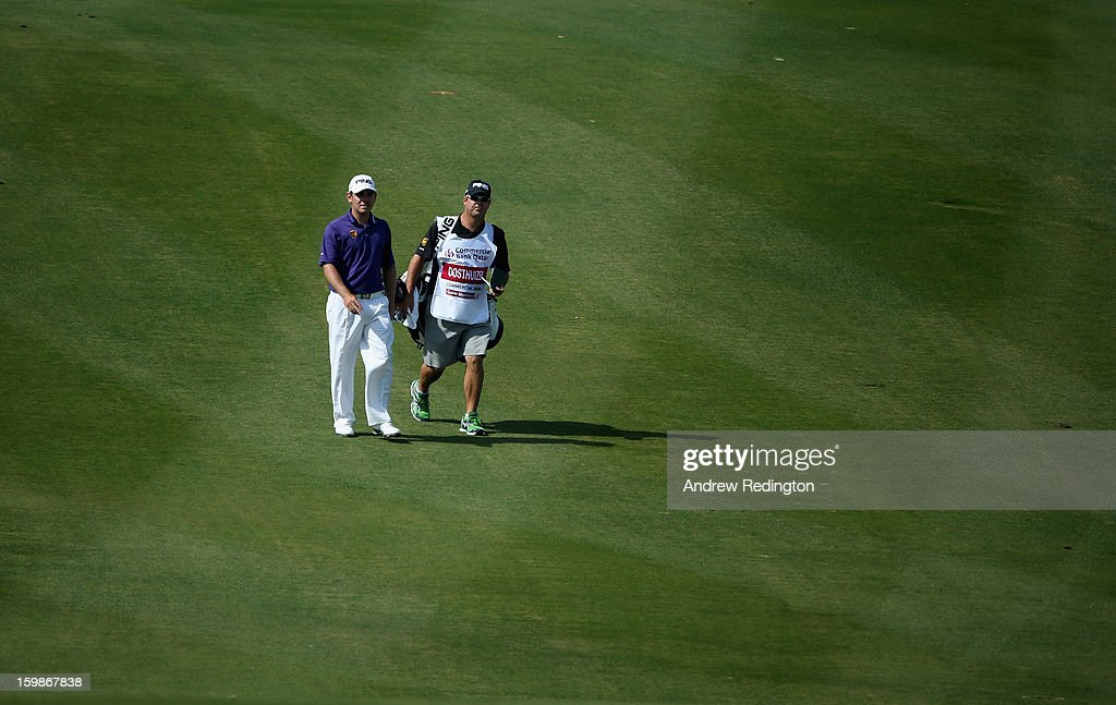 Louis Oosthuizen of South Africa with his caddie Wynand Stander during the Pro Am prior to the start of the Commercial Bank Qatar Masters held at Doha Golf Club on January 22, 2013 in Doha, Qatar.