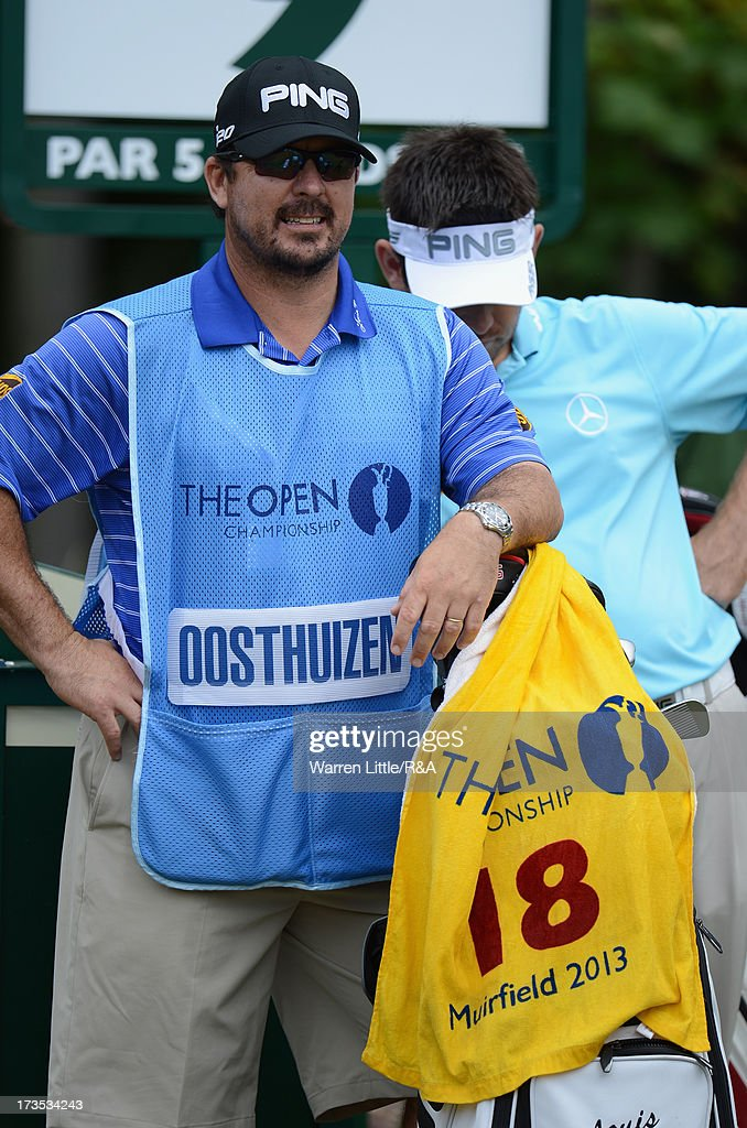 Louis Oosthuizen of South Africa's caddie Wynand Stander looks on ahead of the 142nd Open Championship at Muirfield on July 16, 2013 in Gullane, Scotland.