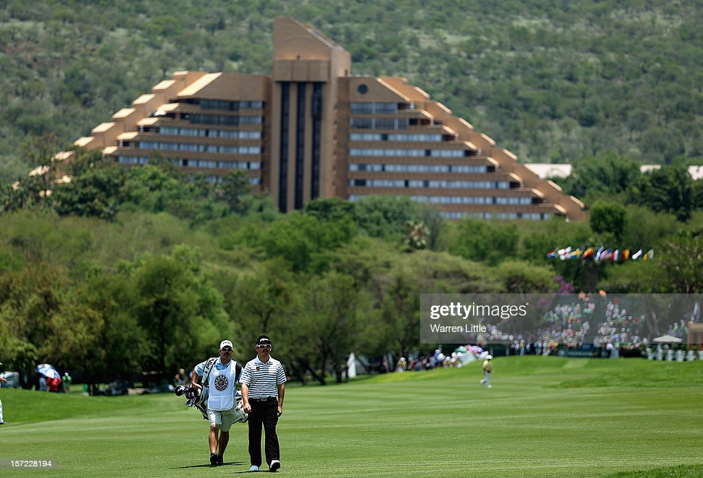 Louis Oosthuizen of South Afriuca walks up the first fairway during the second round of the Nedbank Golf Challenge at the Gary Player Country Club on November 30, 2012 in Sun City, South Africa.
