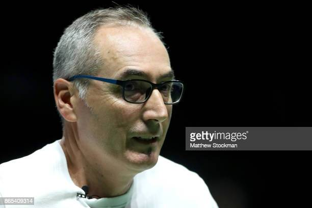 Louis Paul Garcia father and coach of Caroline Garcia of France returns to his box between games in her match against Simona Halep of Romania during...