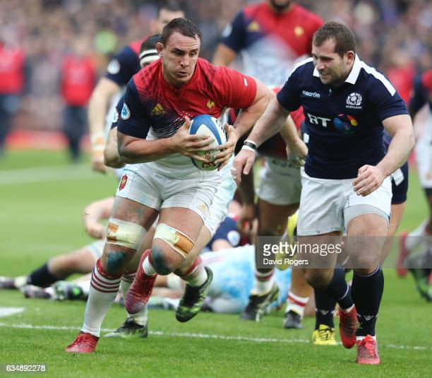 Louis Picamoles of France goes past Fraser Brown of Scotland during the RBS Six Nations match between France and Scotland at Stade de France on...