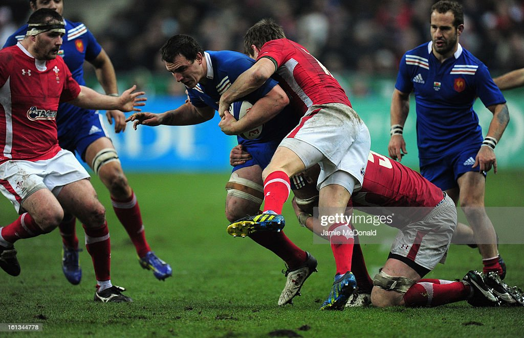 Louis Picamoles of France is tackled by Dan Biggar of Wales during the RBS Six Nations match between France and Wales at Stade de France on February 9, 2013 in Paris, France.