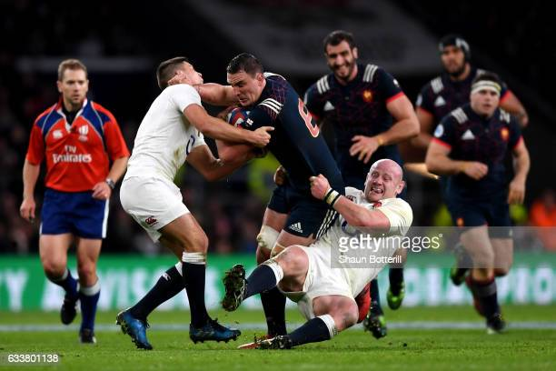 Louis Picamoles of France is tackled by Dan Cole and Ben Youngs of England during the RBS Six Nations match between England and France at Twickenham...