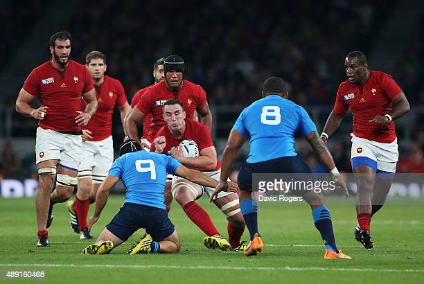 Louis Picamoles of France is tackled by Edoardo Gori of Italy during the 2015 Rugby World Cup Pool D match between France and Italy at Twickenham...