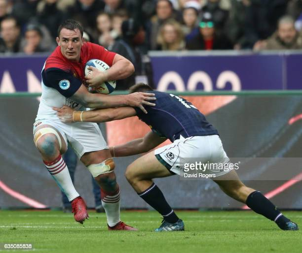 Louis Picamoles of France is tackled by Huw Jones during the RBS Six Nations match between France and Scotland at Stade de France on February 12 2017...