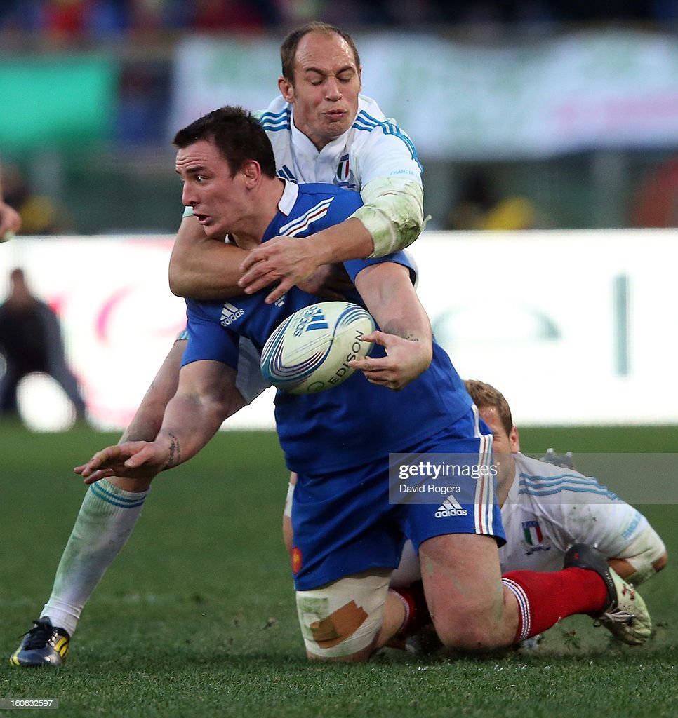 Louis Picamoles of France is tackled by Sergio Parisse during the RBS Six Nations match between Italy and France at Stadio Olimpico on February 3, 2013 in Rome, Italy.