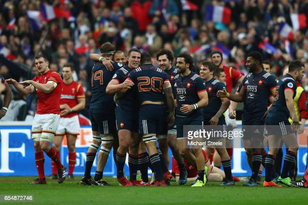 Louis Picamoles of France leads the celebrations after Camille Chat scored the winning try as Sam Warburton of Wales questions the decision of the...