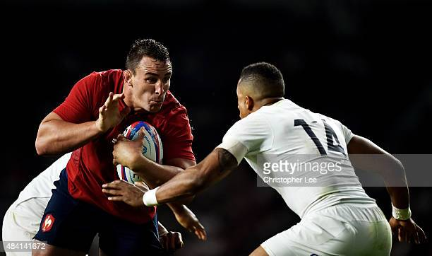 Louis Picamoles of France takes on Anthony Watson of England during the QBE International match between England and France at Twickenham Stadium on...