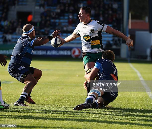 Louis Picamoles of Northampton is tackled by Anthony Jelonch and Jody Jenneker during the European Rugby Champions Cup match between Castres and...