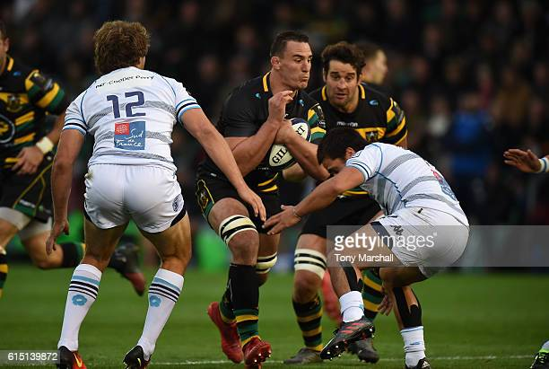 Louis Picamoles of Northampton Saints is tackled by Ben Botica of Montpellier during the European Rugby Champions Cup match between Northampton...