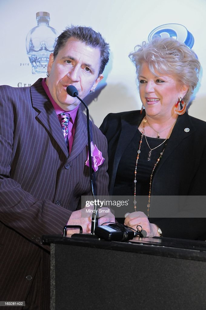 <a gi-track='captionPersonalityLinkClicked' href=/galleries/search?phrase=Louis+Prima+Jr.&family=editorial&specificpeople=6312887 ng-click='$event.stopPropagation()'>Louis Prima Jr.</a> and Las Vegas Mayor Carolyn Goodman attend the Fremont Country Club opening with <a gi-track='captionPersonalityLinkClicked' href=/galleries/search?phrase=Louis+Prima+Jr.&family=editorial&specificpeople=6312887 ng-click='$event.stopPropagation()'>Louis Prima Jr.</a> and The Witnesses at Fremont Country Club on March 6, 2013 in Las Vegas, Nevada.