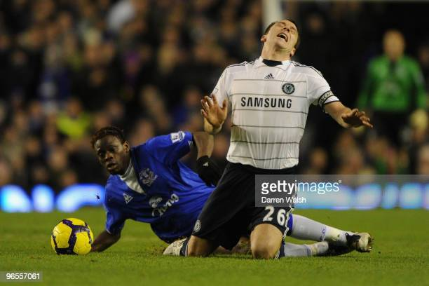 Louis Saha of Everton brings down John Terry of Chelsea during the Barclays Premier League match between Everton and Chelsea at Goodison Park on...
