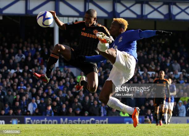 Louis Saha of Everton competes for the ball with Ramires of Chelsea during the FA Cup sponsored by EOn Fourth Round match between Everton and Chelsea...
